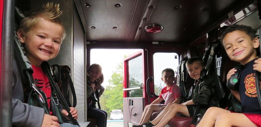 kindergarten students sitting in fire truck