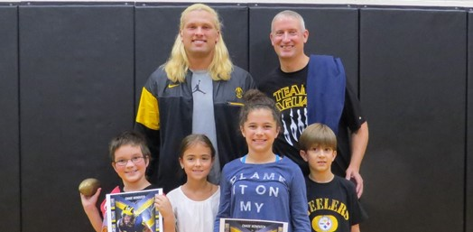 McClellan students with Principal Liberatore and Chase Winovich