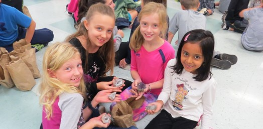 Third graders holding geodes at McClellan