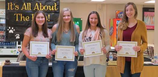 high school students with certificates at board meeting