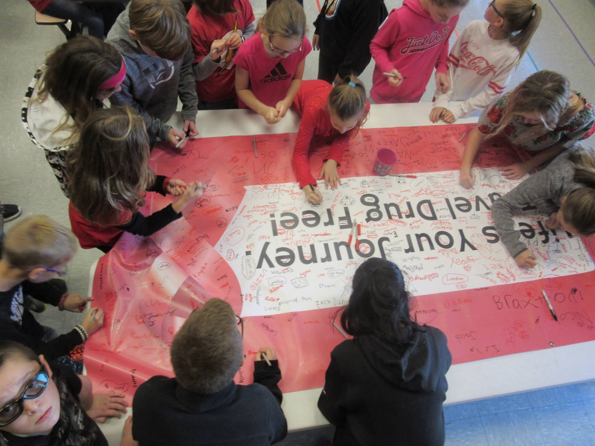 Students signing drug-free pledge