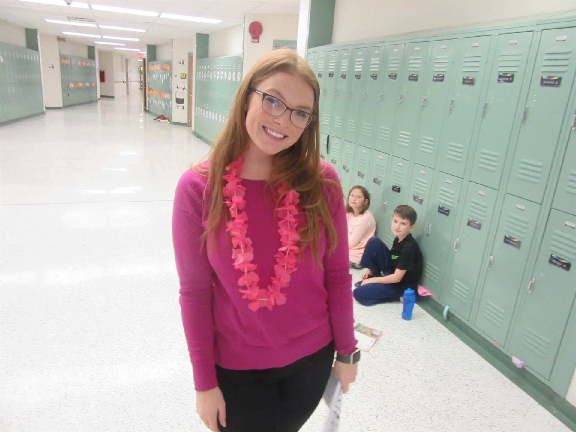 Teacher with flower leis on Hawaiian theme day