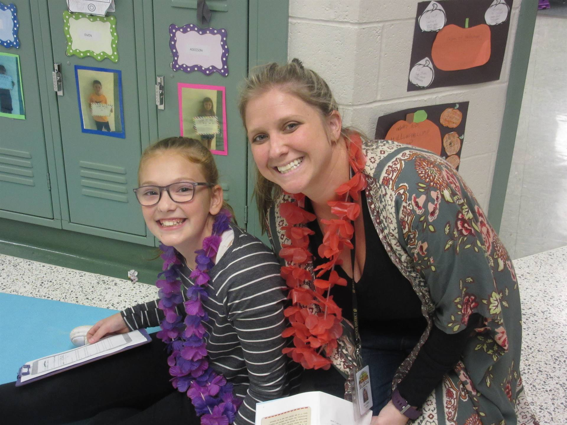 Students and Teacher with flower leis on Hawaiian theme day