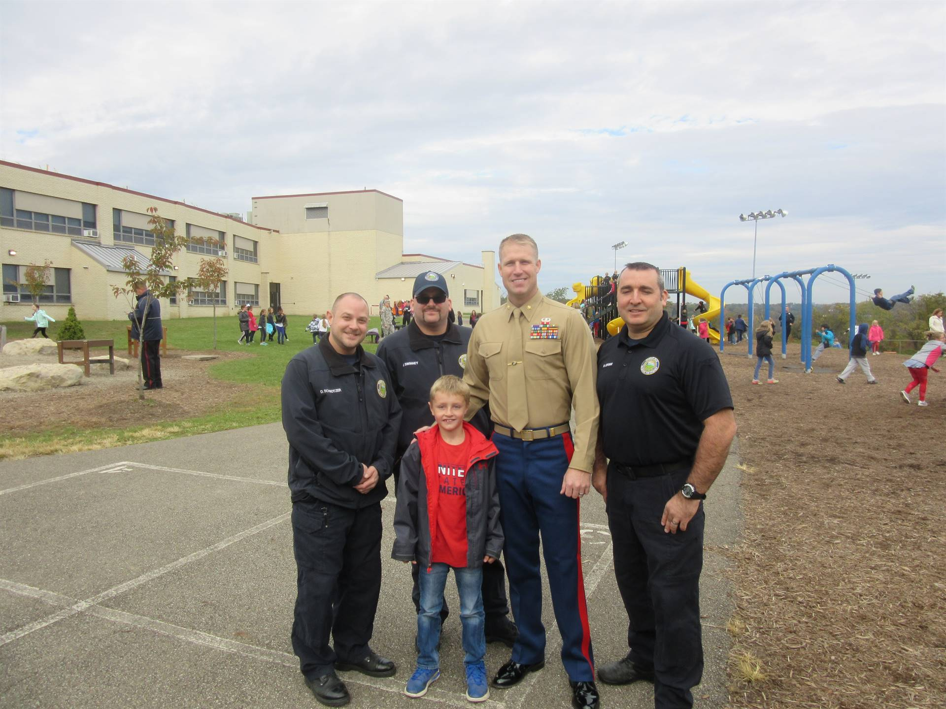 First Responders on playground with kids at recess