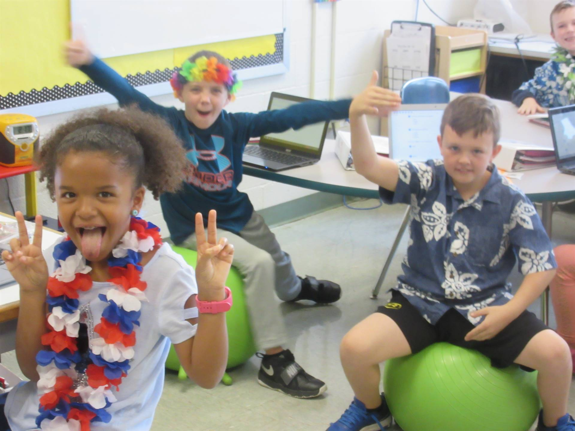 Students with flower leis on Hawaiian theme day
