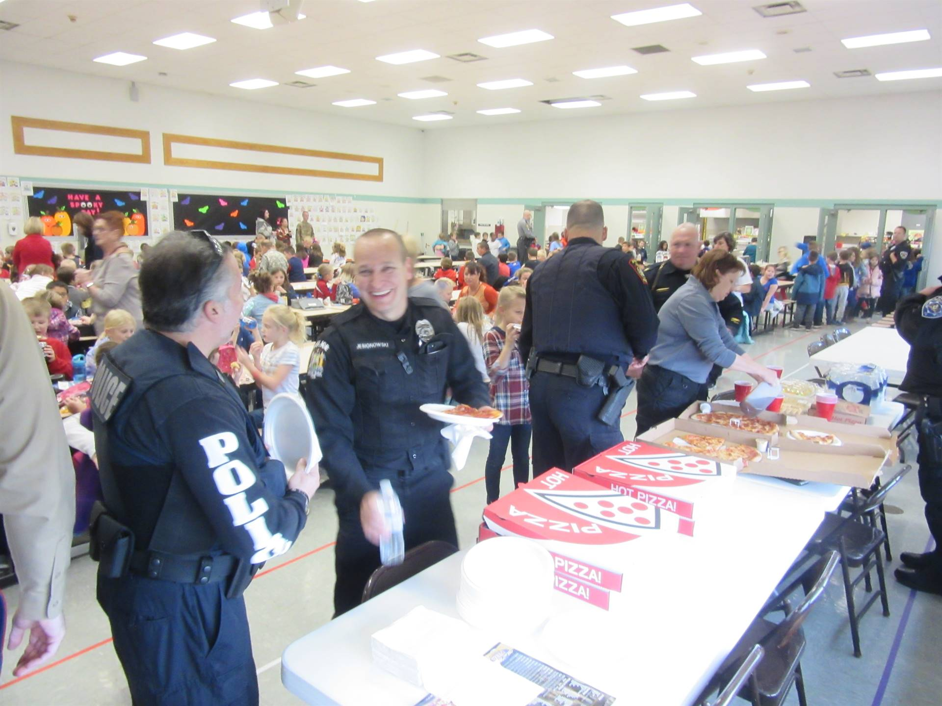 First Responders eating lunch with kids in cafeteria