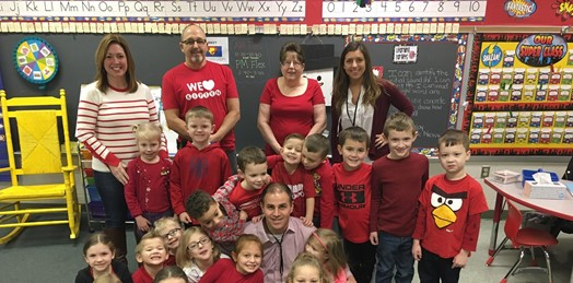 kindergarten classroom dressed in red and seated in group