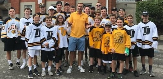 TJ Hockey players posing at Community Day with Pittsburgh Dad