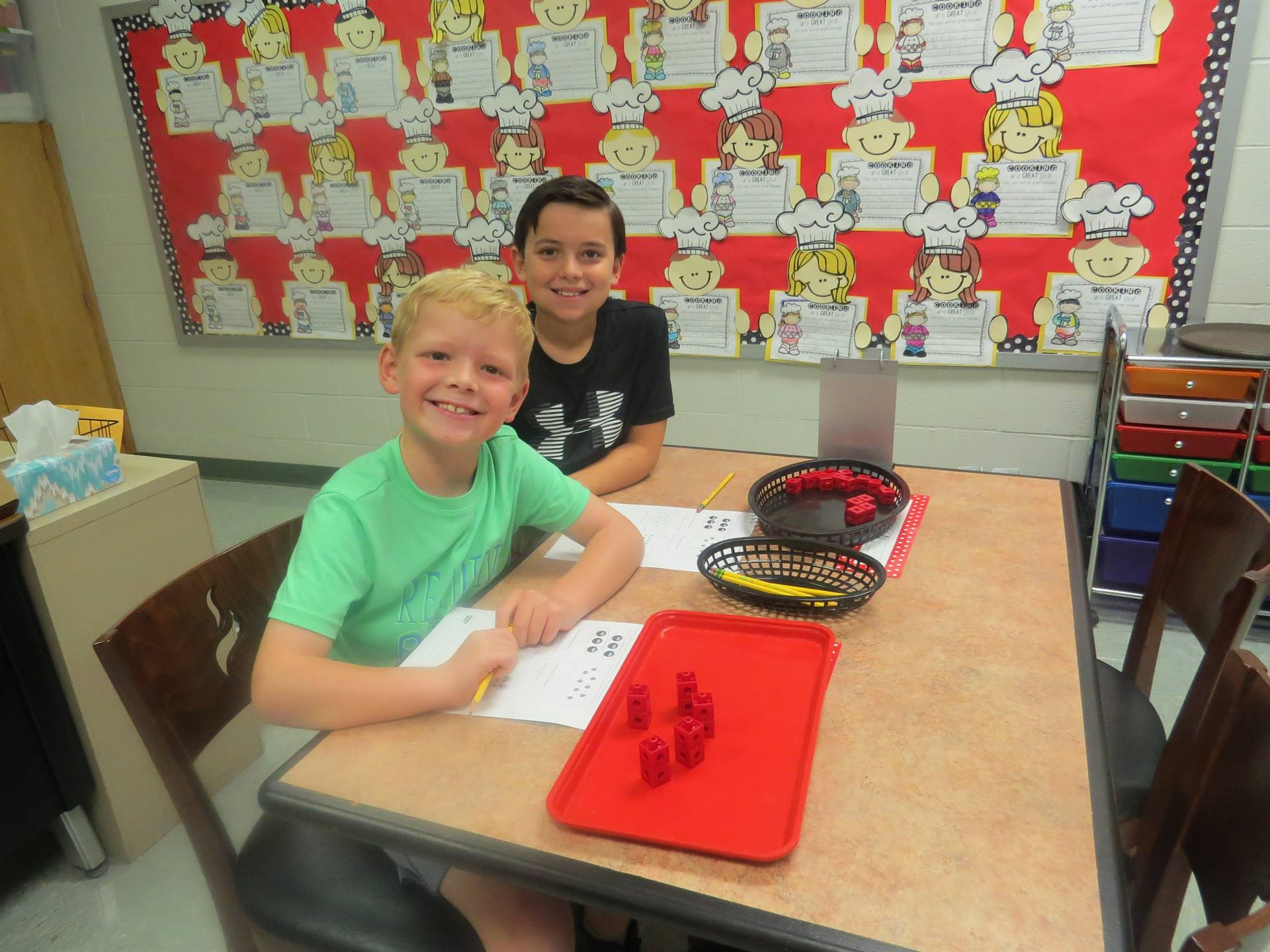 3rd Grade male students working in math class