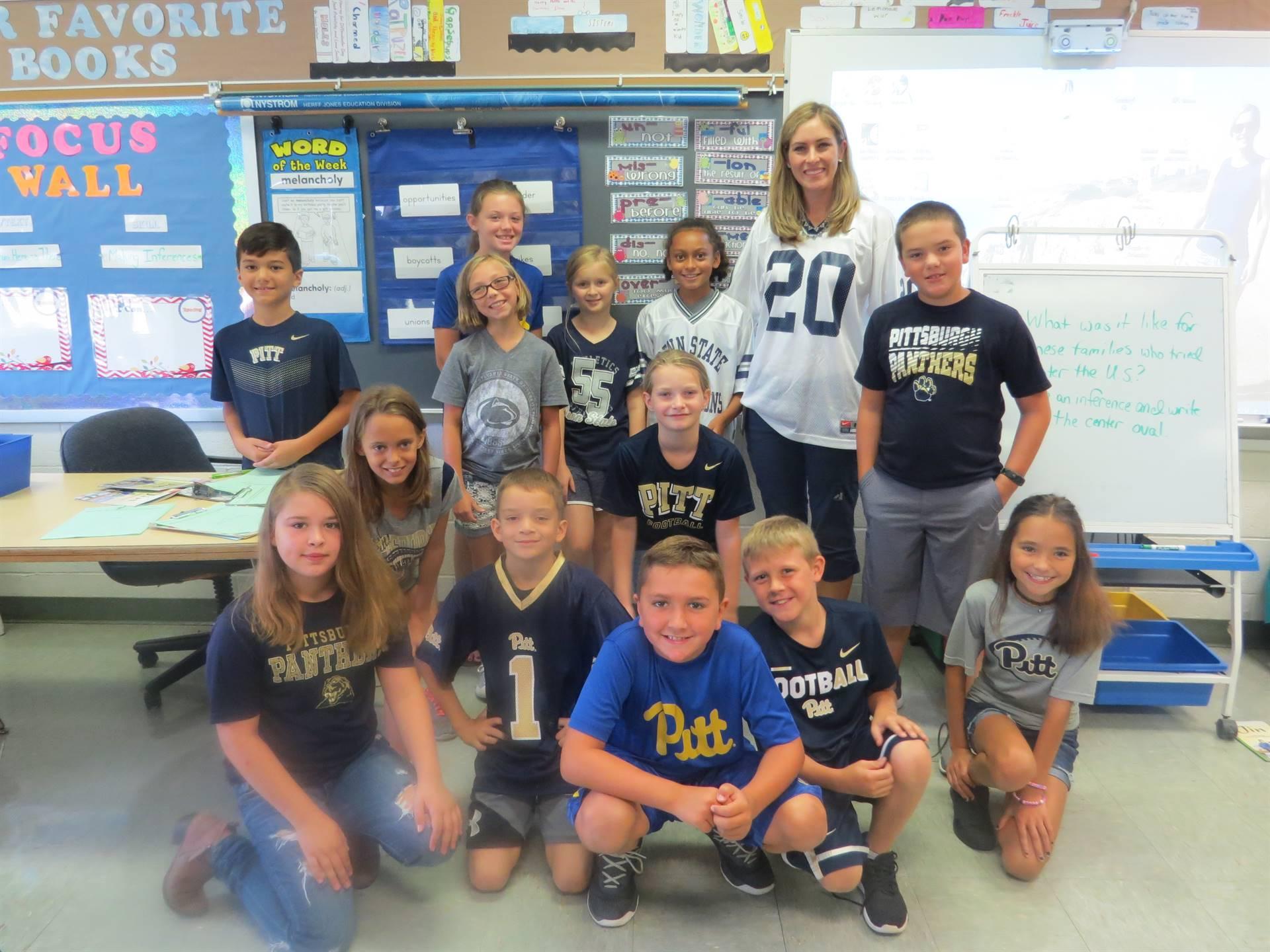 Group class photo with students wearing Pitt Penn State football jerseys