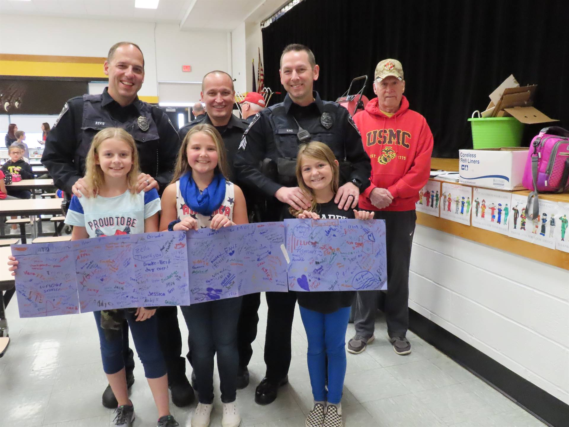 First responders with daughters and their thank you cards