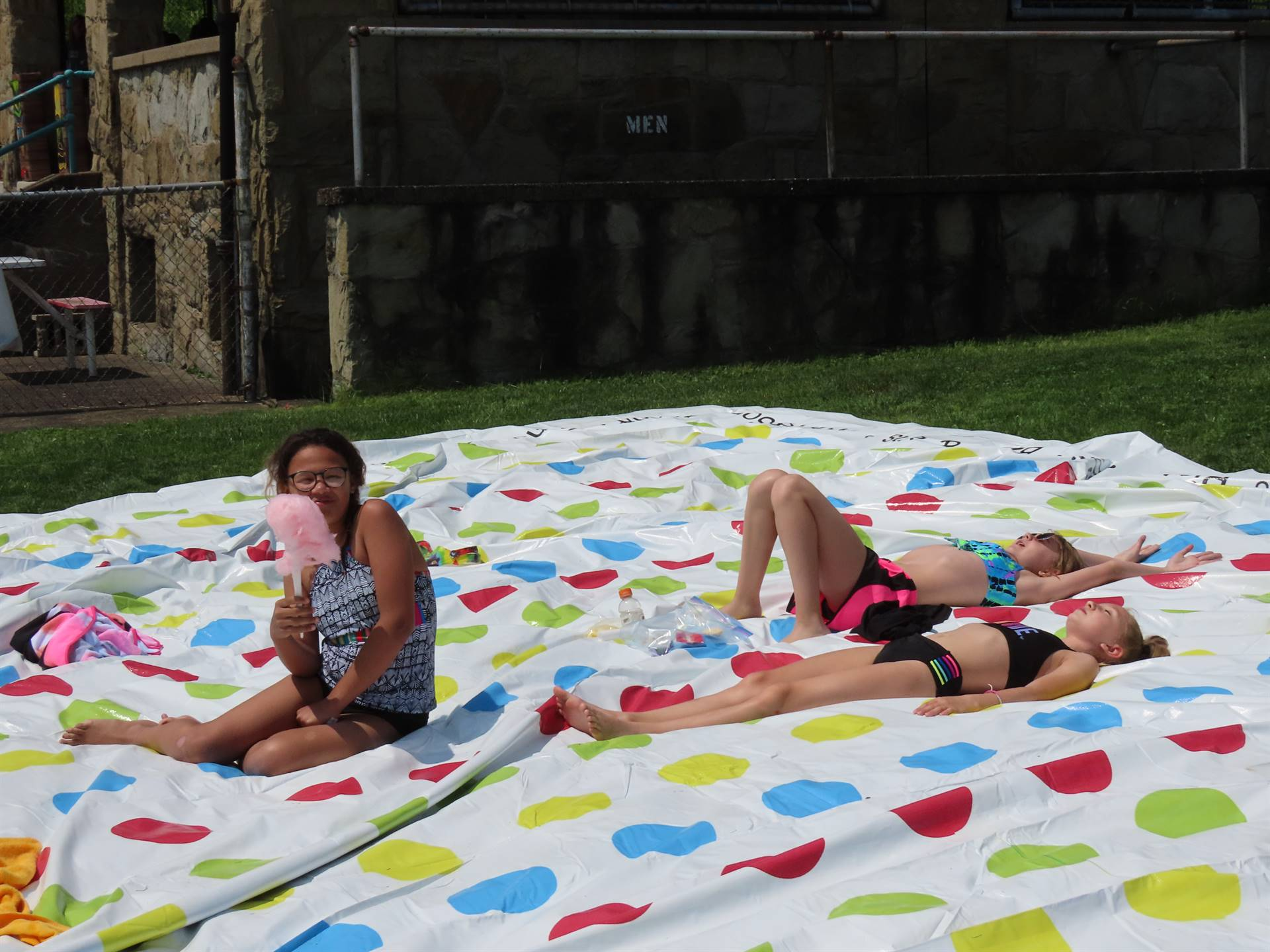 Girls on beach blanket