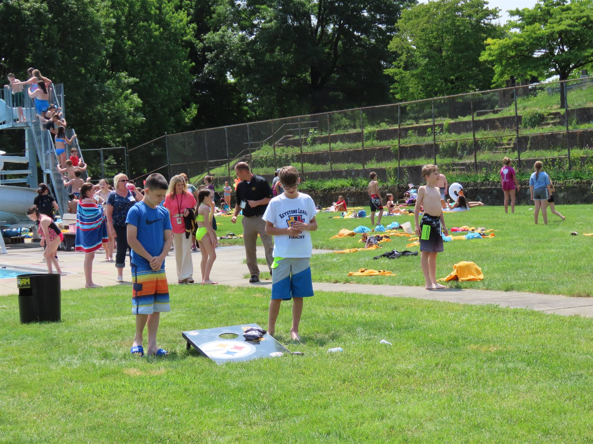 Kids playing corn hole