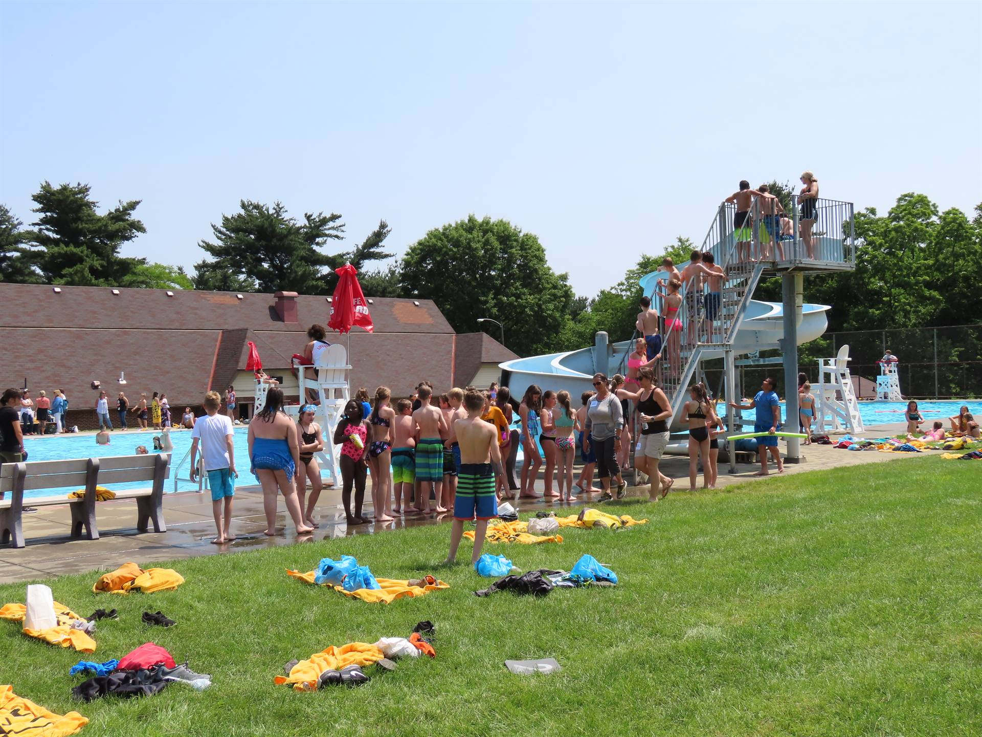 Kids waiting their turn in line for pool slide