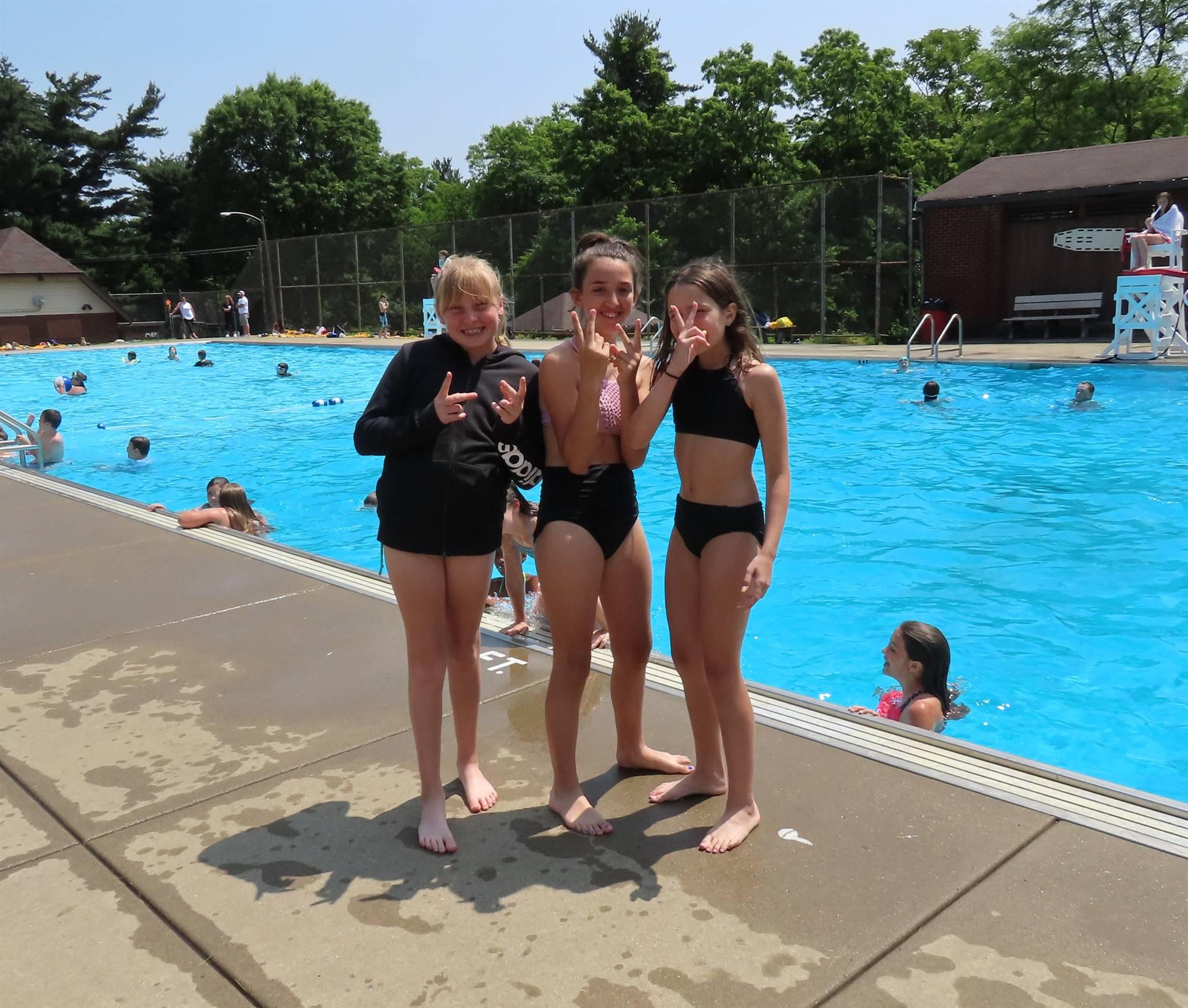Girls posing poolside