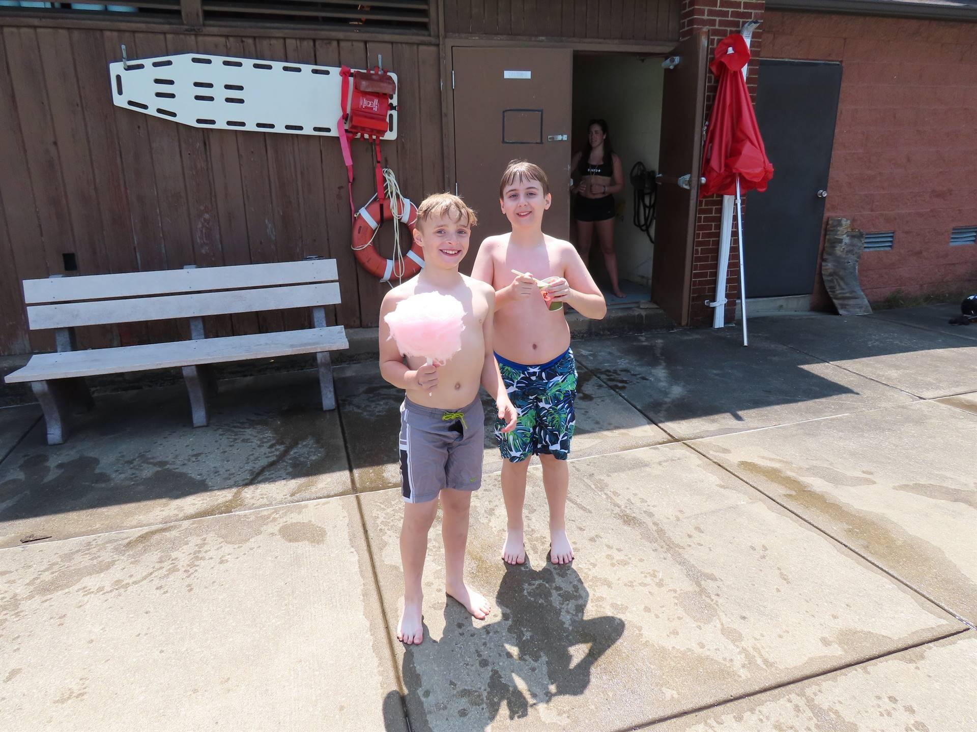 Boys enjoying snacks poolside