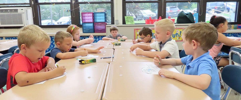 kindergarten students working at desks