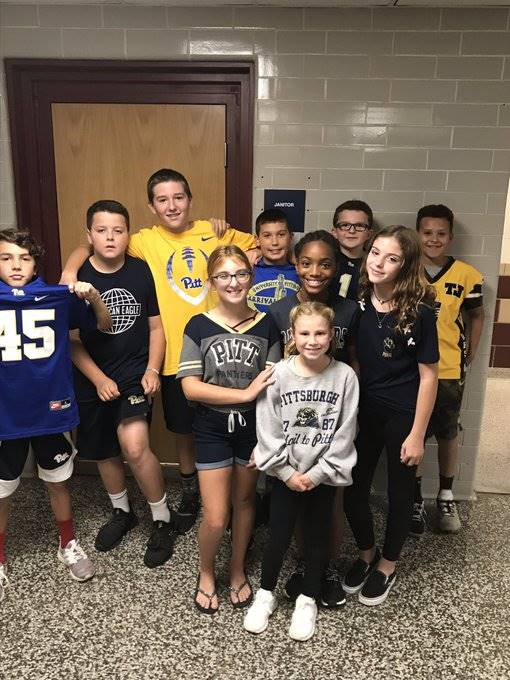 middle school students in Pitt shirts