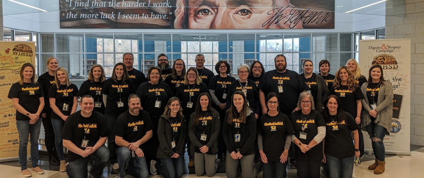Group photo of TJ High school staff in the Kind Kid t shirts