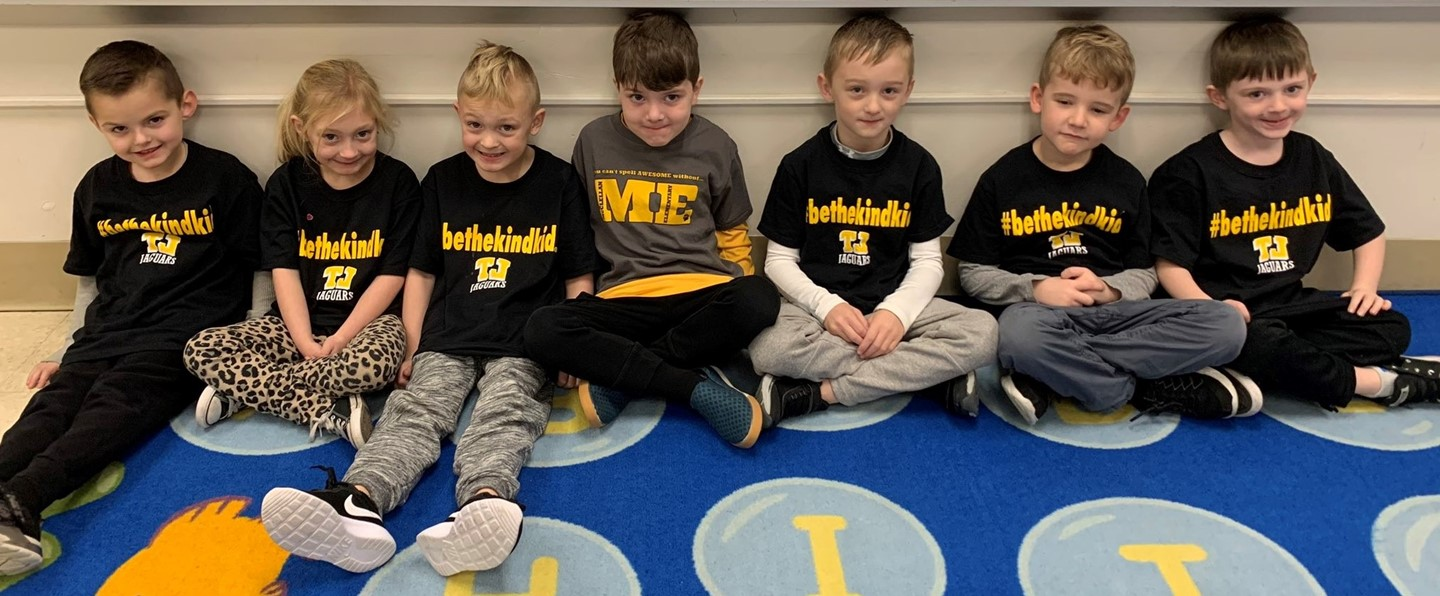McClellan students sitting on floor with their kind shirts on