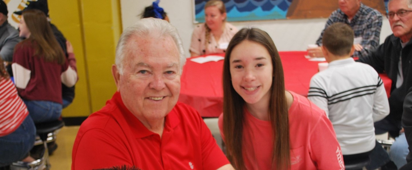 Student with grandparent at school breakfast