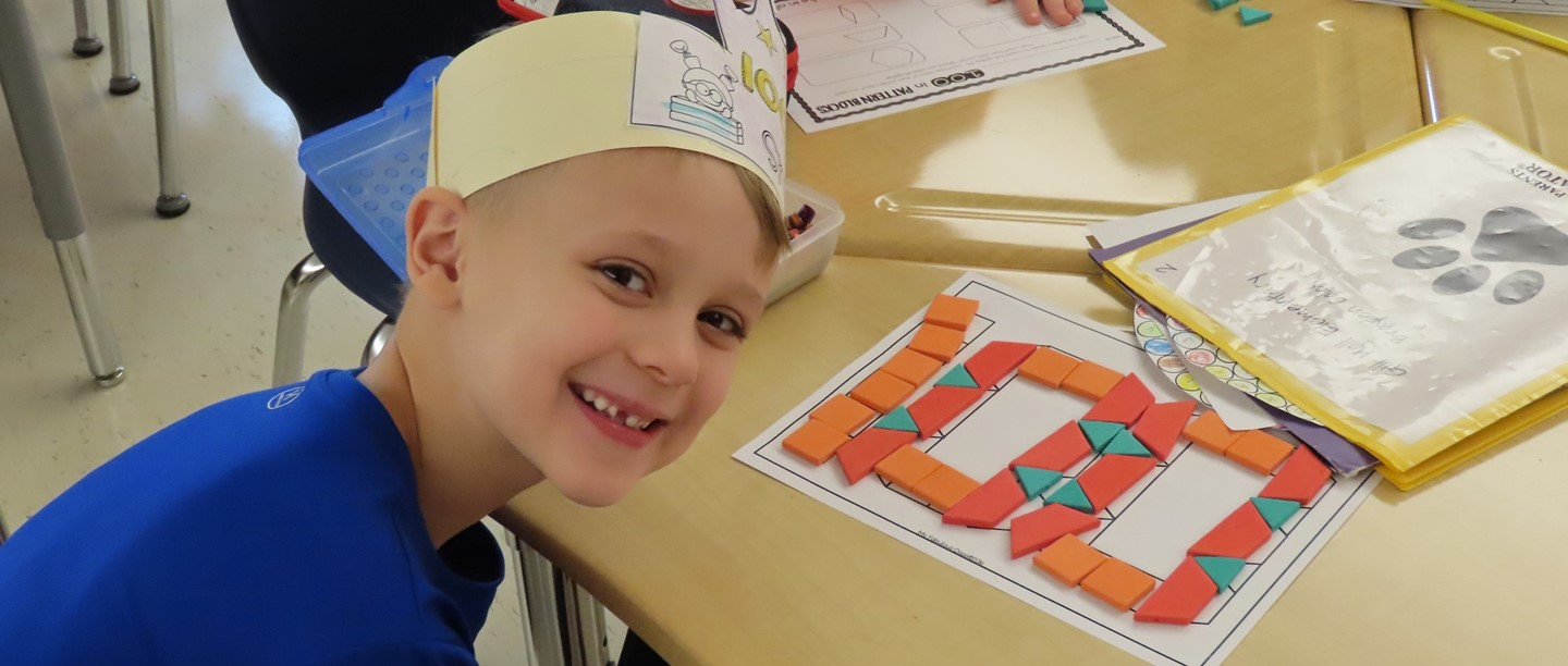 Student with his completed 100 day math puzzle