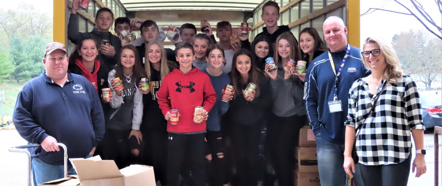 Student Council Members loading up the Food Bank Truck