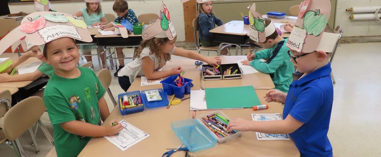 Kindergarten students coloring