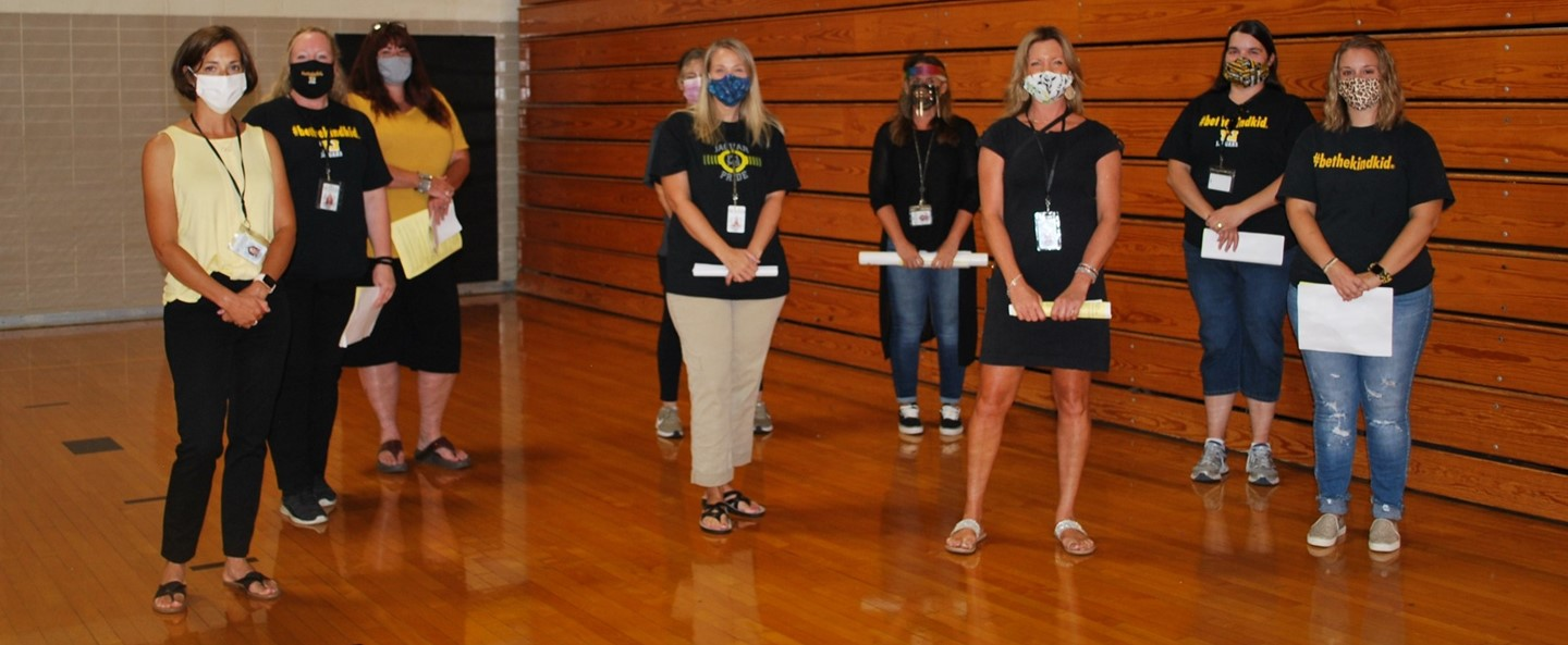teachers in masks at student orientation