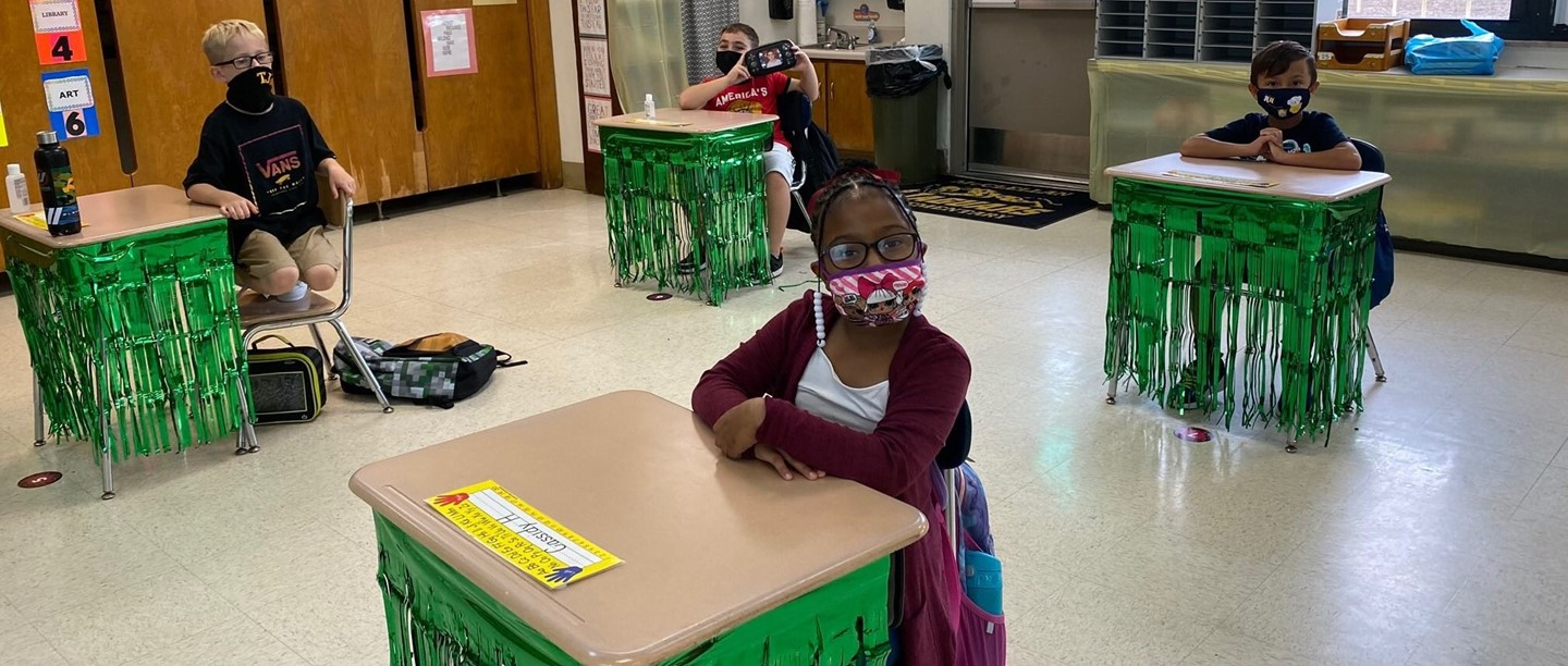 Elementary students in classroom with masks