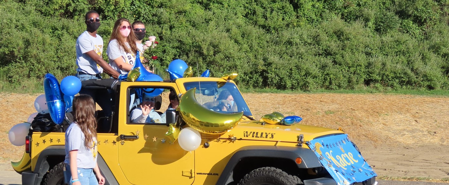 students in back of jeep