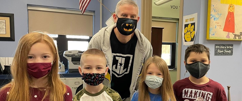 Principal Liberatore with 4 students