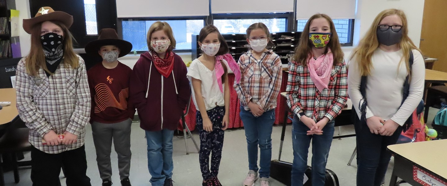 7 students with masks on wearing western attire